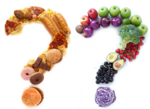 Unhealthy and healthy food ingredients in a the shape of question marks alongside each other