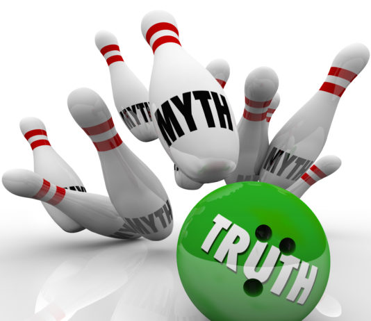 Myth busting with a bowling ball marked Truth striking pins illustrating myths to symbolize shedding light on and dispelling untruths or lies with honesty, sincerity and investigation of facts